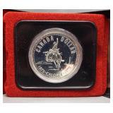 1975 Canadian 50% silver dollar.