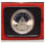 1976 Canadian 50% silver dollar.