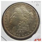 1902-O Morgan silver dollar.