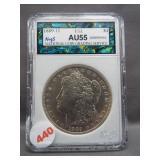 1889-O Morgan silver dollar. NCGS AU55.