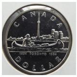 1984 Canadian 50% silver dollar.