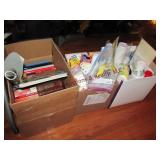 3 boxes w/ paper goods & cookbooks