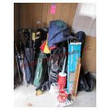 4 sets of golf clubs w/ bags, umbrellas, balls,
