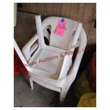 2 plastic lawn chairs & 1 side table