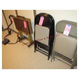 6 metal folding chairs: 4 black, 2 grey,