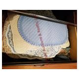 Contents in 3 drawers: Tablecloths, placemats,