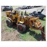Case vibratory plow/rod bore has Onan gas engine,