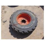 Bobcat 8 hole wheel w/ Deestone tire 12-16.5 NHS