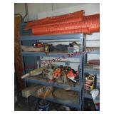 Shelf & contents: orange barrier fence, tool belt,