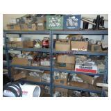 2 shelves w/ contents: PVC fittings, sprinkler