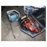 2 chainsaws: Homelite XL-12 (motor locked) &