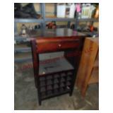 Wood cocktail table w/ wine shelf & drawer...