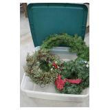 Plastic tub with three large Christmas wreaths