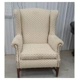 Stretcher base wing back chair