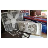 2 fans with boxes