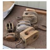 5 wooden pulleys