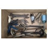 Box of tools, puller, oil cans, wrenches