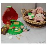 Basket full of strawberry shortcake related items