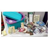 Plastic craft tote full of embroidery kits and