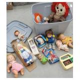 Gray tub full of dolls, cabbage patch recorder,