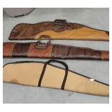 3 soft gun cases 2 leather, 1 cloth