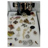 Group of jewelry including many brooches and