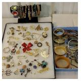 Group of bracelets, and many brooches and pins