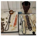 2 displays of jewelry includes many necklaces,