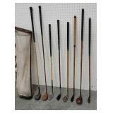 8 Wooden and fiberglass golf clubs with bag