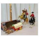 box of toys including covered wagon and horses