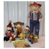 Box of fall decor scarecrows and flag
