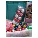 Clear plastic tub full of Christmas bulbs and