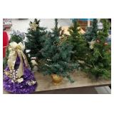 7 small artificial Christmas trees - 2 pre-lit