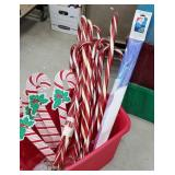 Red tub of Christmas includes light up lawn candy