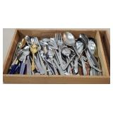 Wooden box of stainless steel flatware