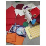 Box of miscellaneous linens including red table