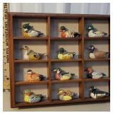 Shadow box display full of enesco ducks