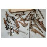 Box of old wrenches and other tools