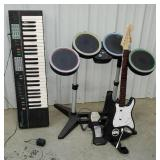 Kids Fender guitar, drums, and Yamaha keyboard -