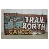 Wooden Trail North canoes sign - damaged