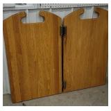 Pair of oak swinging doors missing one hinge