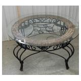 Glass and iron round coffee table