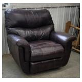 Brown leather recliner out of smokers house use