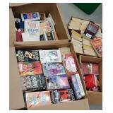 4 large boxes of paperback books -