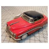 Red tin Cadillac Friction toy