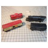 Tin Lionel engine, tender, baby ruth & Mar Caboose