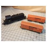 3pc Lionel Diesel Electric Engine & 2 cattle cars