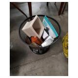 Waste basket full of miscellaneous household