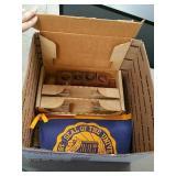 Box of vintage flag and shot glasses