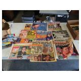 Box of old enquirer magazines